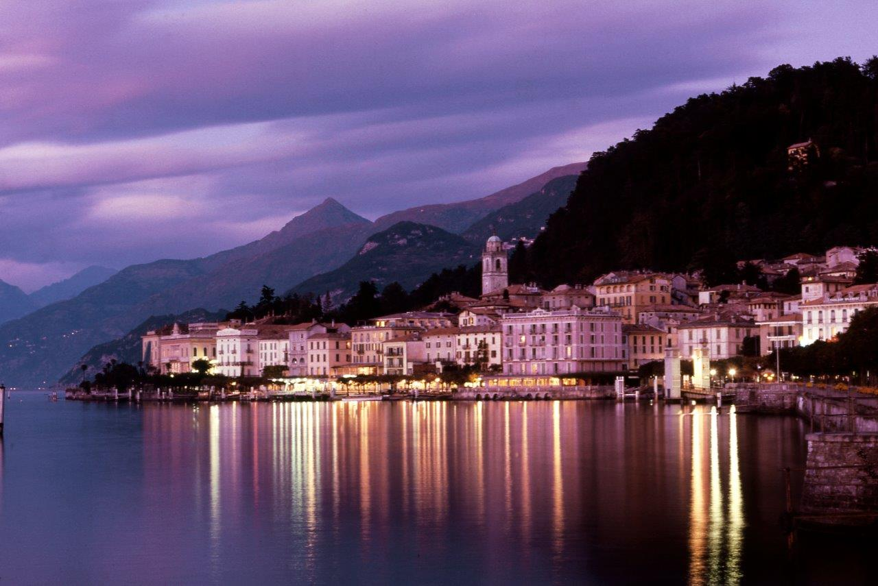 View of Bellagio at night, twilight, water Blue Walk Italy European walking vacation