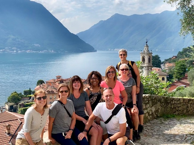 Italy walking vacation lake como smiling group picture