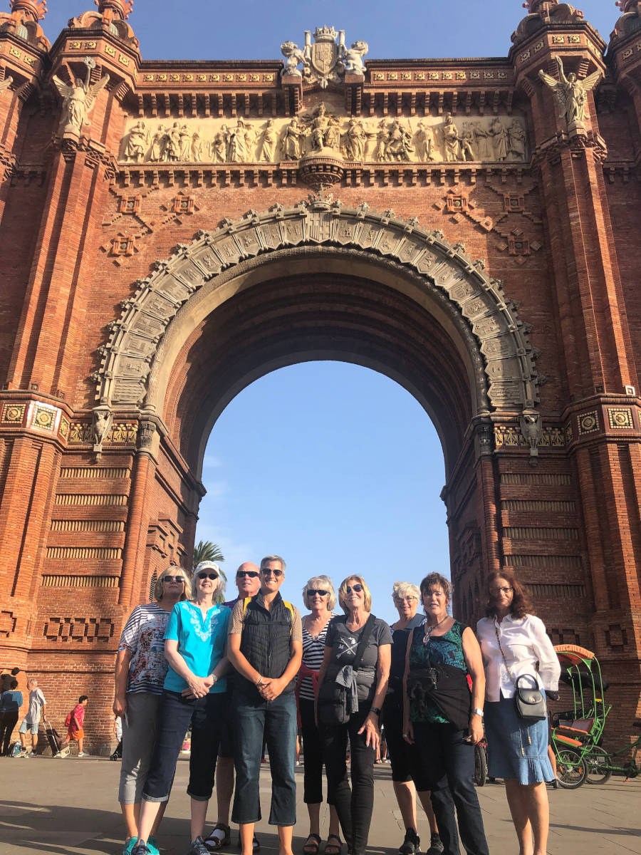 Blue Walk group of people in front of arch in Barcelona Spain walking tour vacation agent