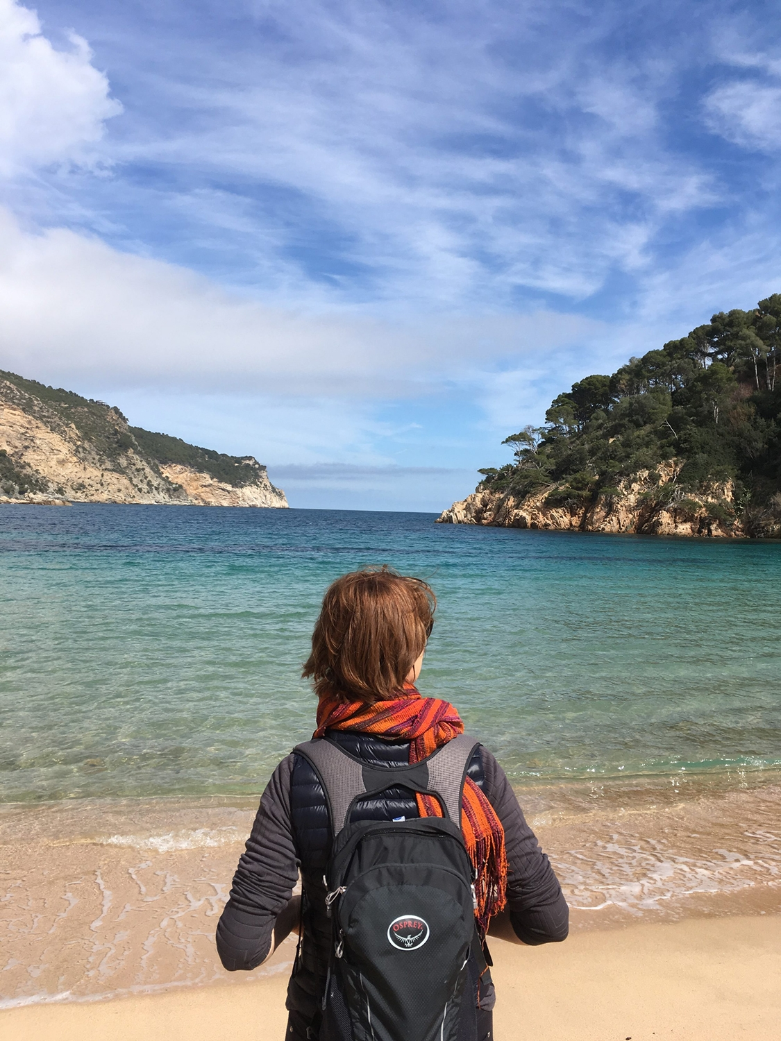 woman looking at water on walking vacation in spain