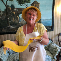 Sue Coggins making pasta in Parma, Italy on ArtWalk Private tour