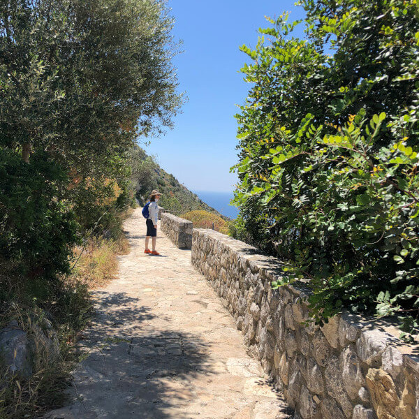Woman on stone path Italy walking vacation