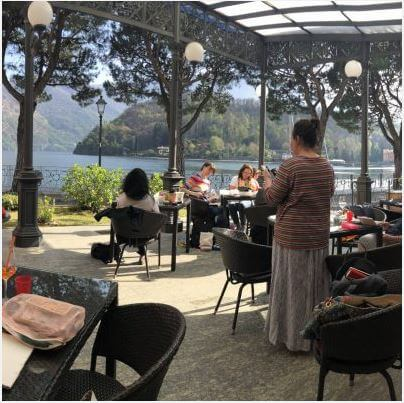 Students working on terrace lake como art journal workshop in italy art vacation square