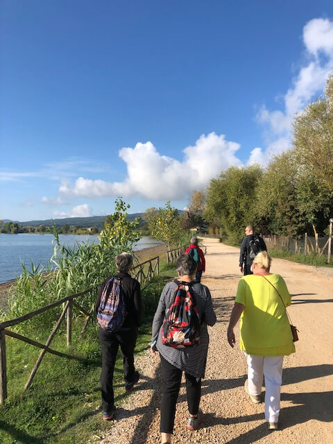 Group of people walking Lake Bolsena Italy
