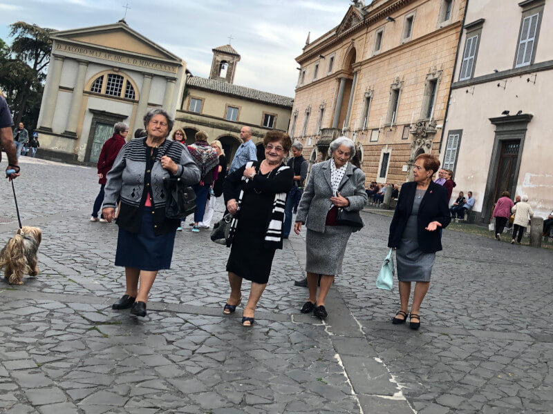 Senior Italian women walking in piazza duomo Ovieto umbria walking vacation