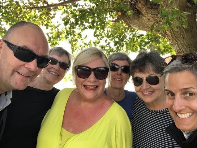 group smiling people lake bolsena umbria italy walking vacation