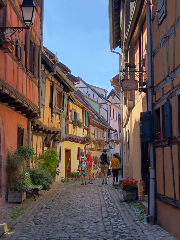 Touring Eguisheim France cobbled streets with small walking group